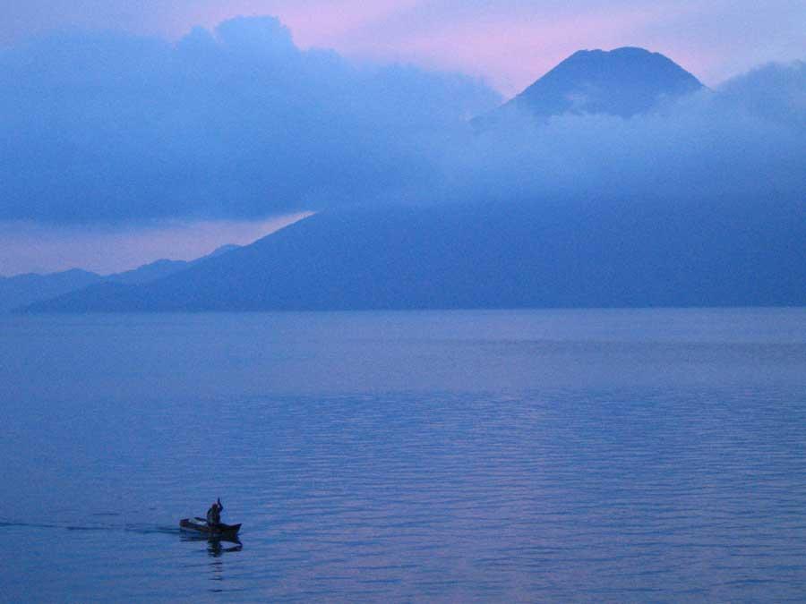 Laguna-Lodge-volcano-and-fisherman